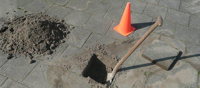 Hoe stort ik een grondanker?